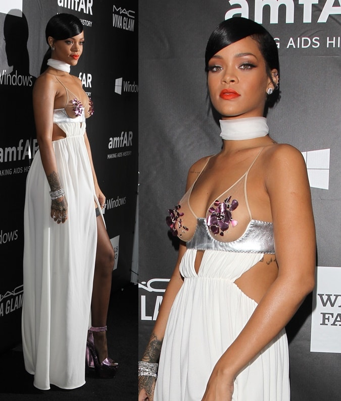 Rihanna wore the Tom Ford creation with a pile of diamond jewelry, black thigh-high hosiery, and metallic platform sandals in the same lavender shade as the floral decoration on her dress.
