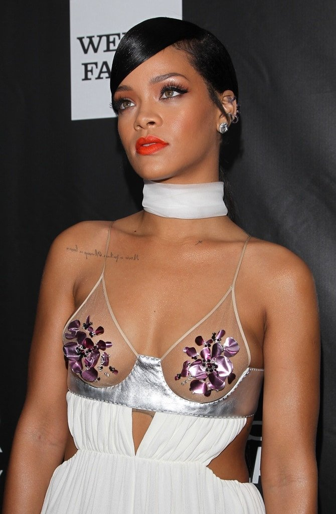 Rihanna wearing a see-through white dress to the 2014 amfAR Gala held at Milk Studios in Hollywood on October 29, 2014