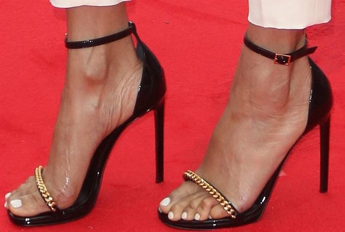 Alesha Dixon wearing black chain-accented sandals
