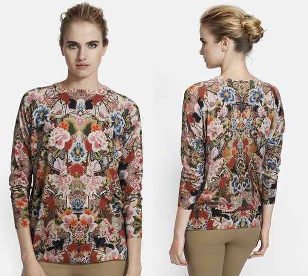 A three-quarter-sleeve crewneck sweater makes a romantic statement thanks to a lavish floral print