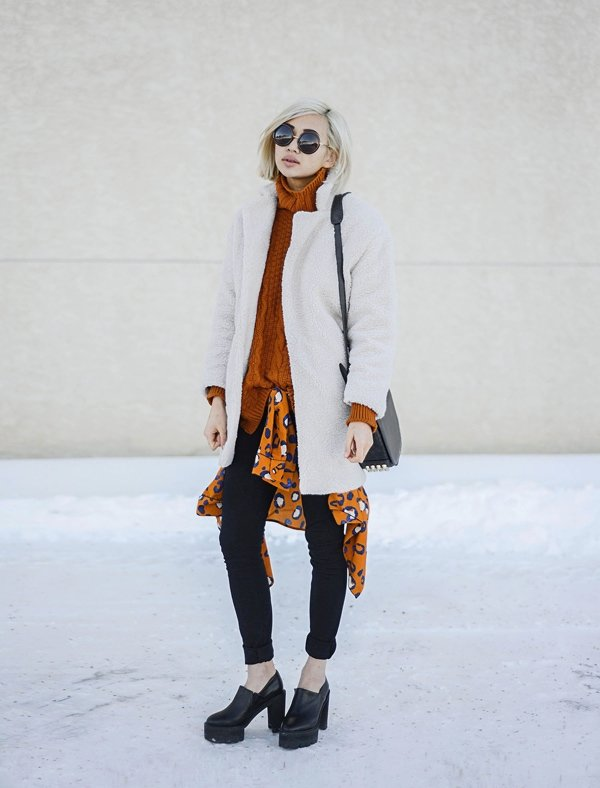 Alyssagave her turtleneck sweater street style vibe with a printed shirt tied around her waist