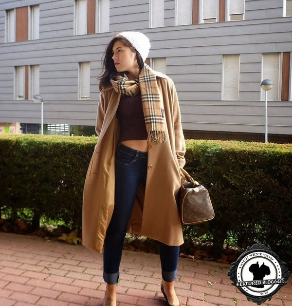 Ana flashes washboard abs in a camel Burberry-esque winter outfit