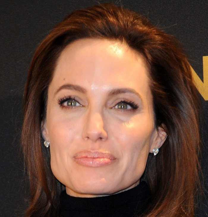 Angelina Jolie attends the photocall for the film Unbroken on November 27, 2014 in Berlin, Germany