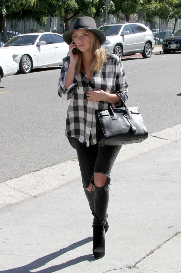 Ashley Benson wearing a gingham plaid top with ripped jeans