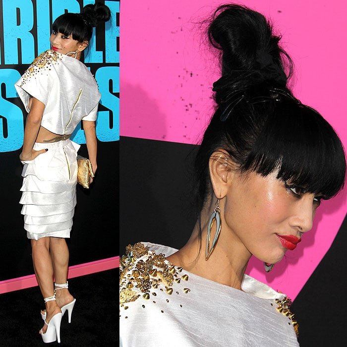 Bai Ling showing different angles of her top-piled bun hairdo, pearl hoop earrings, gold-studded structured Kimono top, pleat-tiered skirt, and ankle-tie platform sandals