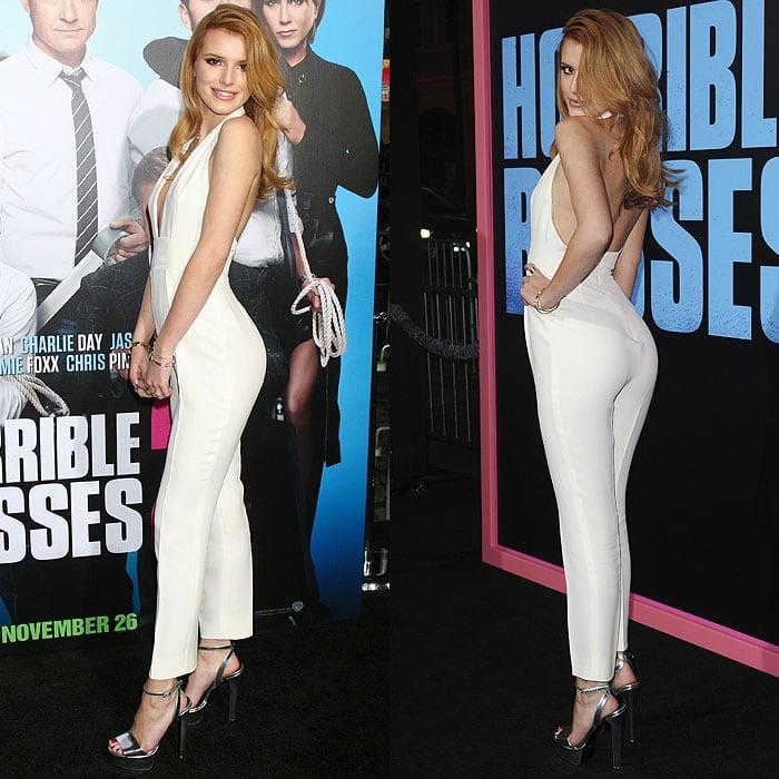 Bella Thorne flaunting her backside through over-the-shoulder poses
