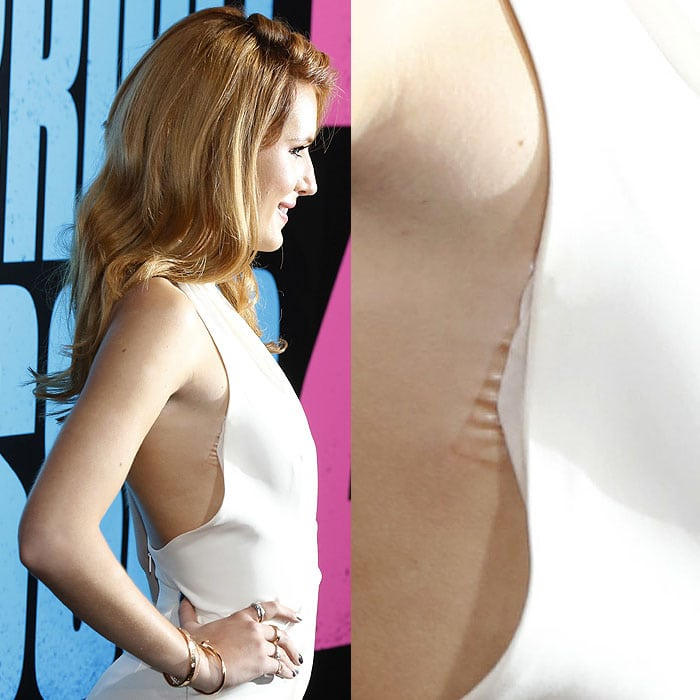 Wardrobe Malfunction: Double-sided tape peeling off the side of Bella Thorne's Gucci halter jumpsuit