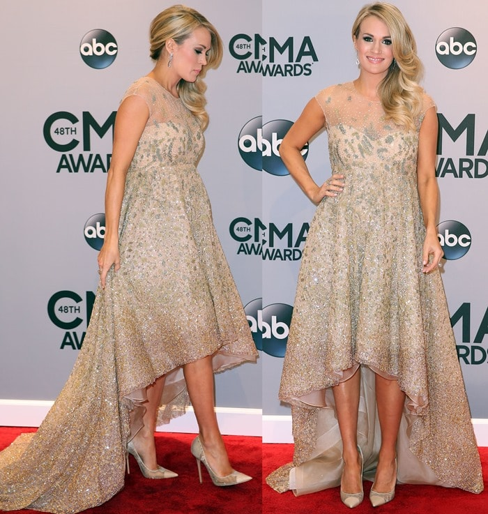 Carrie Underwood'sfully hand-beaded gold ombre gown by Lorena Sarbu
