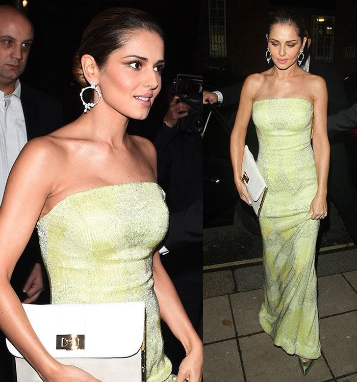Cheryl ina shimmering floor-length strapless lime green gown that flattered her slim figure