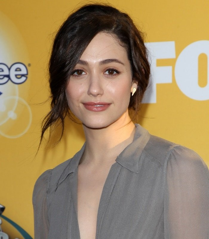 Emmy Rossum shows off her earrings by Renee Sheppard