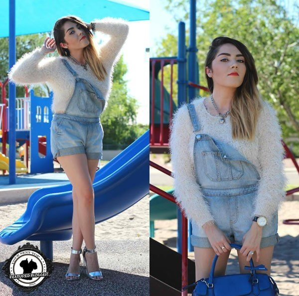 Esmirna inlight-washed denim overalls and a fuzzy sweater