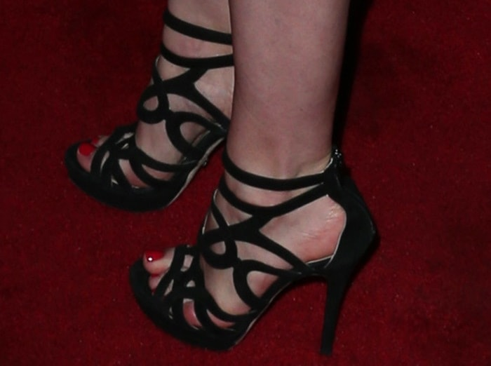 "Gillian Jacobs in cutout ""Orner"" sandals by Jerome C. Rousseau"