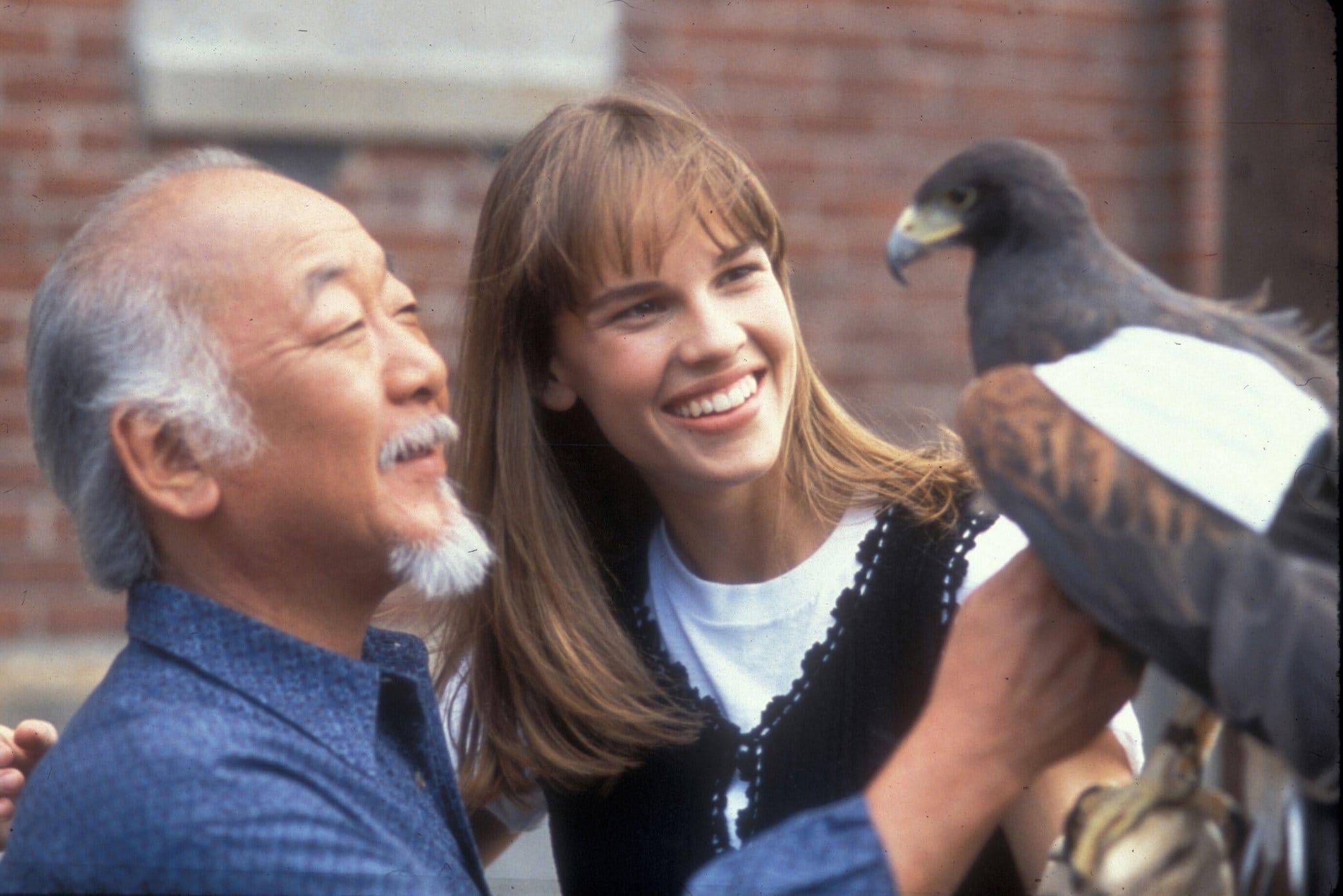 """Hilary Swank as Julie Pierce and Noriyuki """"Pat"""" Morita as Mr. Miyagi in The Next Karate Kid"""