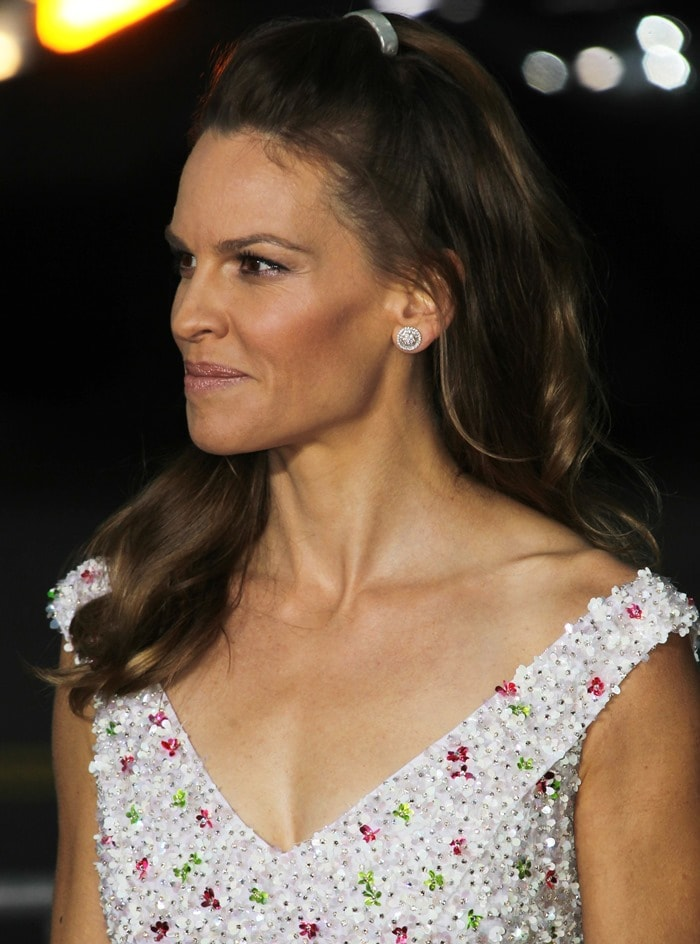 Hilary Swank in a stunning white flower-beaded and sequined dress from Nicholas Oakwell Couture