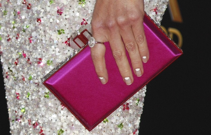 Hilary Swank toting a pink Judith Leiber Couture clutch