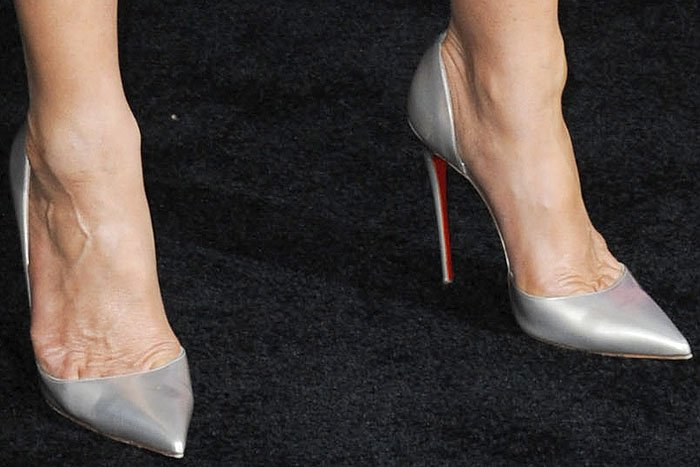 "Jennifer Aniston's hot feet in Christian Louboutin ""Iriza"" half-d'Orsay pumps"