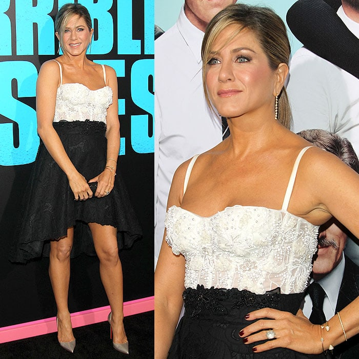 Jennifer Aniston finished her look with a loose side-parted ponytail, pinkish makeup, and maroon nails