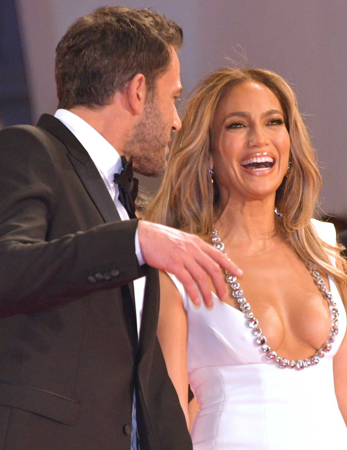 Jennifer Lopez shows cleavage in a white mermaid Georges Hobeika dress with a Swarovski-embellished plunging neckline