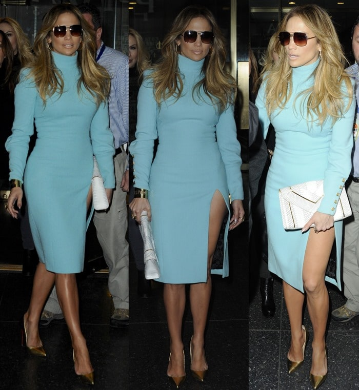 Jennifer Lopez styled the mock turtleneck dress with a VC Signature 'Enve' clutch, 'Condor Aviator' sunglasses by DITA, and stunning gold 'So Kate' pumps by Christian Louboutin