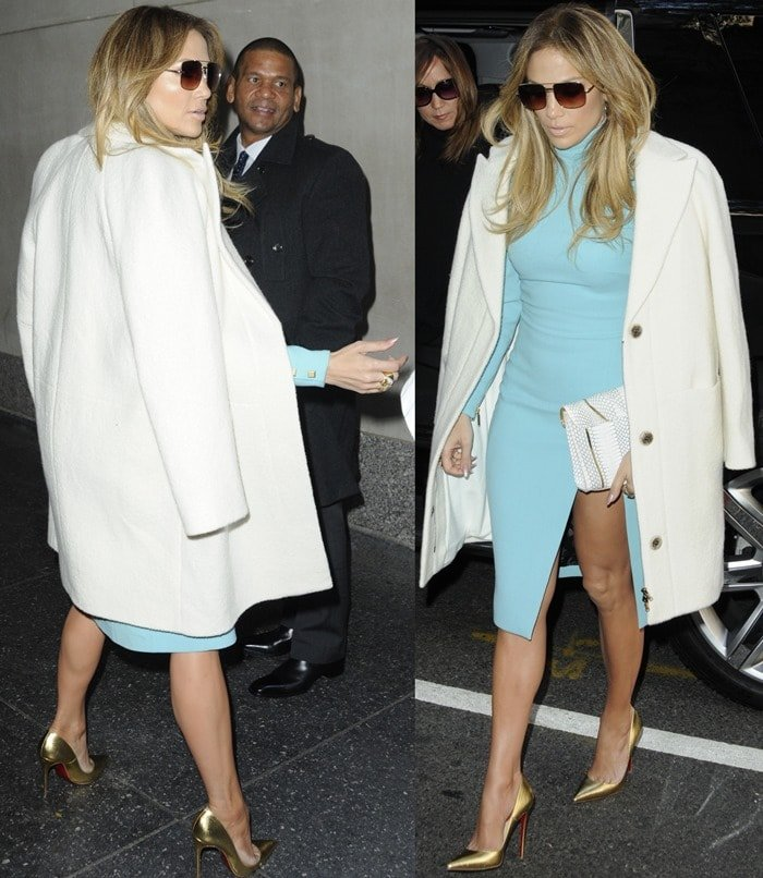 Jennifer Lopez sported a white coat over a tight powder blue dress by Emanuel Ungaro, which flaunted her toned legs