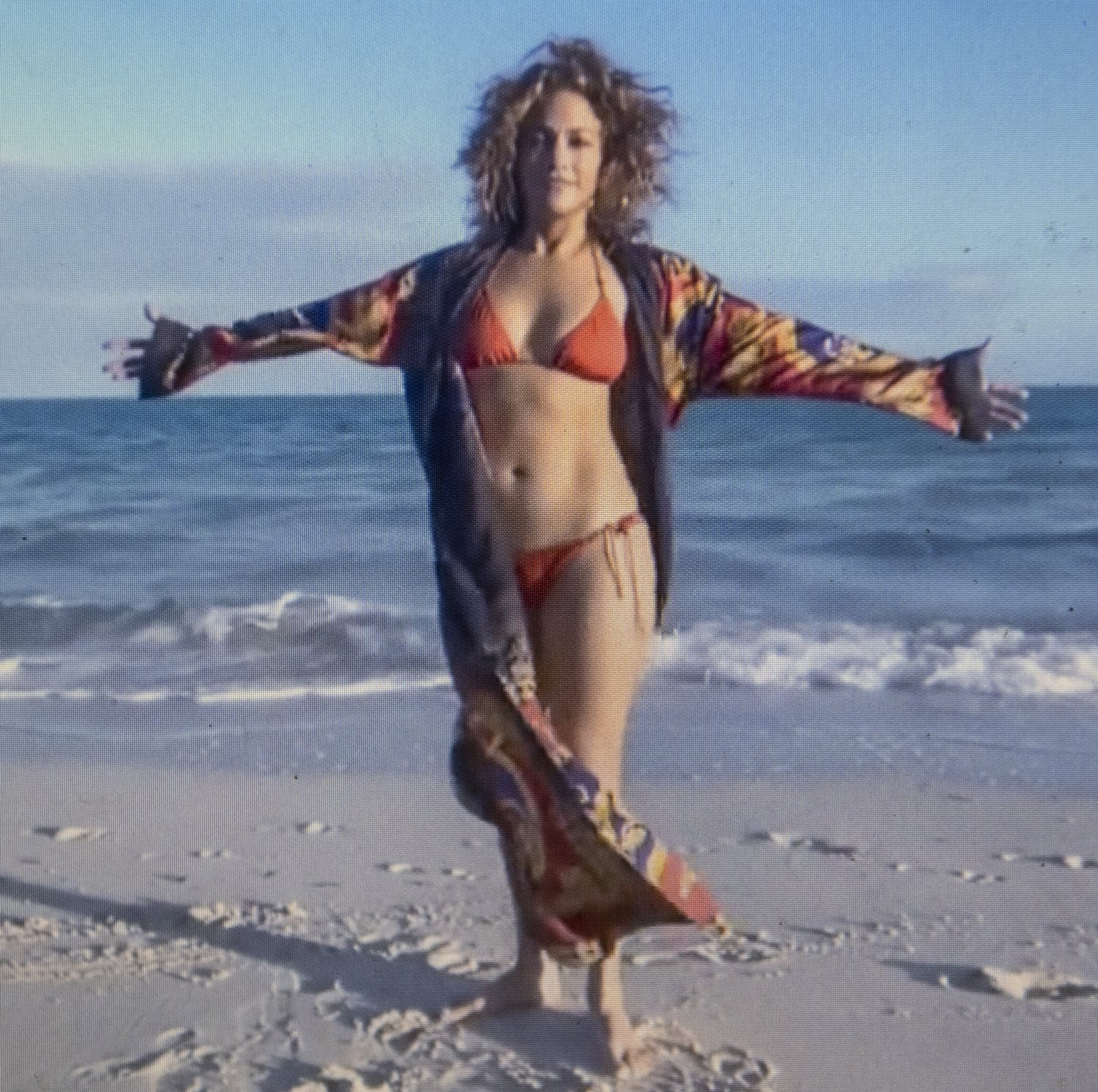 Wearing a red string bikini and a personalized robe in January 2021, Jennifer Lopez says men like her normal height and weight
