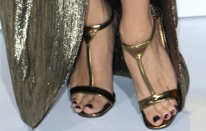 Jessica Simpson shows off her toes in gold metallic heels