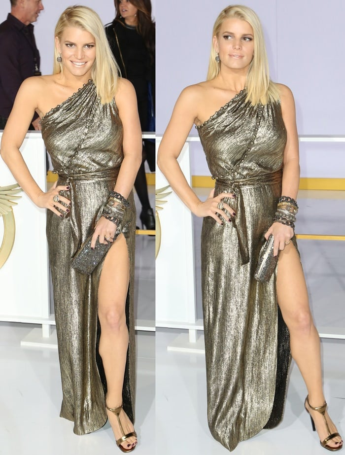 Jessica Simpson shows off her legs in a vintage gold dress