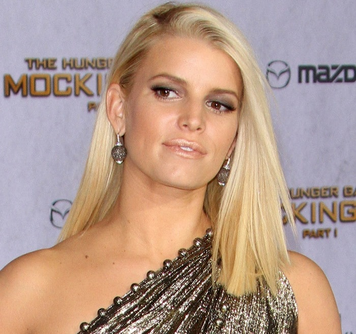 "Jessica Simpson wears her blonde hair down at the premiere of ""The Hunger Games: Mockingjay — Part 1"""
