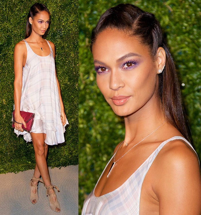 Joan Smalls'hair was pulled away from her flawlessly made-up face ina braided half up-do