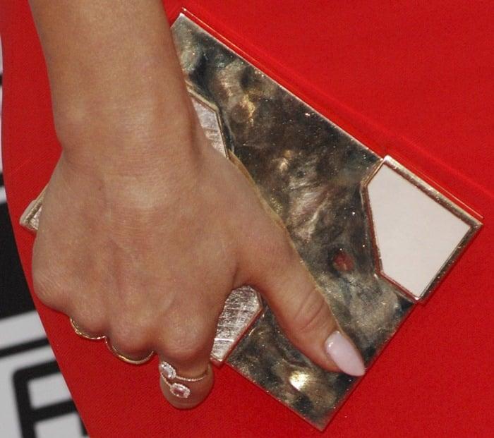 Julianne Hough toting a Lee Savage clutch