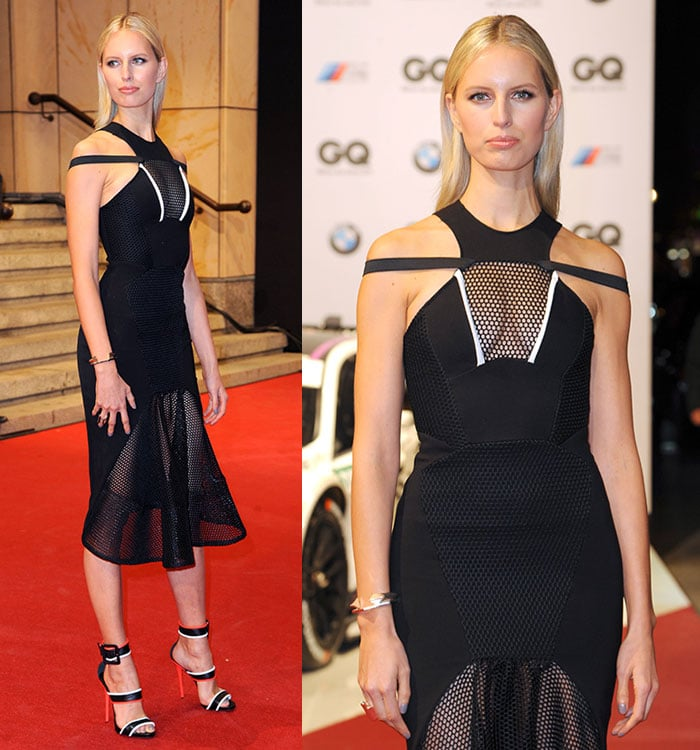 Karolina Kurkova's dress features cutouts at the shoulders, a fitted bodice with a see-through netted panel at the chest area, and a flared net skirt