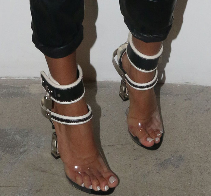 Karrueche Tran shows off her feet in DSquared2 leather elaphe-PVC sandals