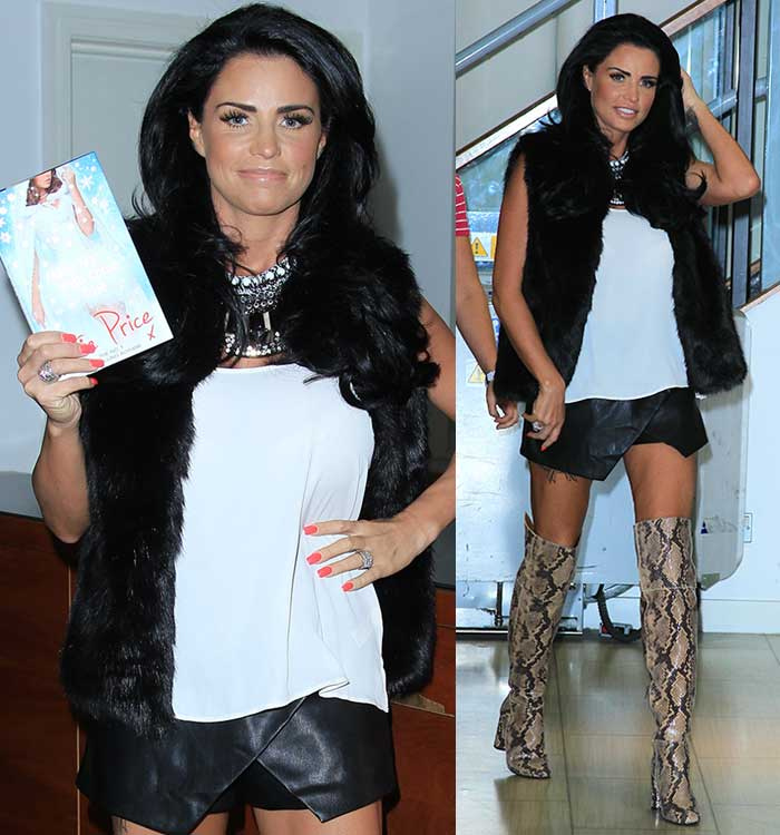 Katie Price in a relativelydemure ensemble consisting of a white top, leather skorts, and a furry vest
