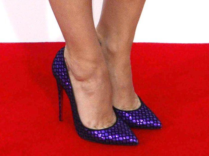 Katy Perry shows off her feet in purple glitter shoes