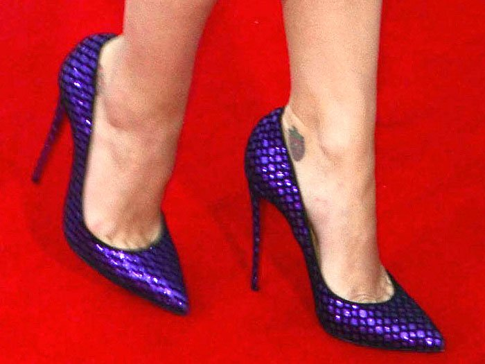 "Katy Perry's purple Christian Louboutin ""Pigalle Follies"" glitter pumps flocked with velvet fishnet"