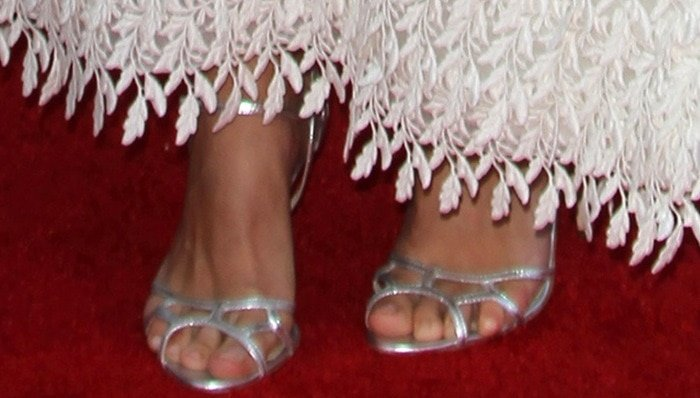 Keira Knightley shows off her sexy feet insilver sandals