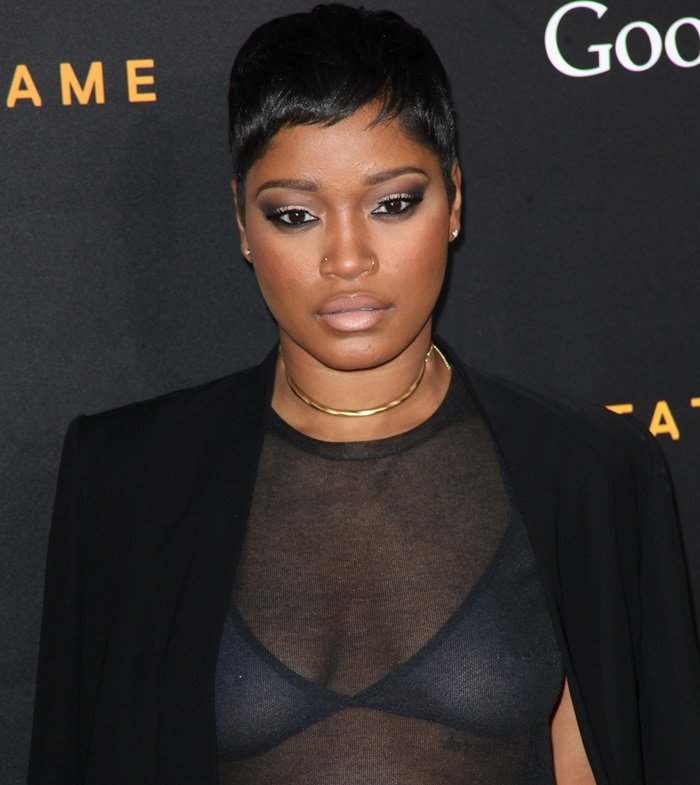 Keke Palmer in a round-neck sheer top that left her thin bra completely visible