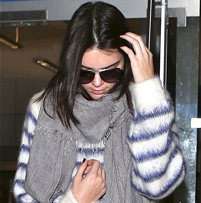 Kendall Jenner wearing a long-sleeved knit sweater in a soft mohair blend by H&M and a long gray scarf
