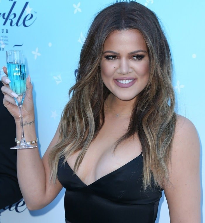 Khloe Kardashian making a toast at the HPNOTIQ Sparkle Launch at Mr. C in Beverly Hills on November 3, 2014