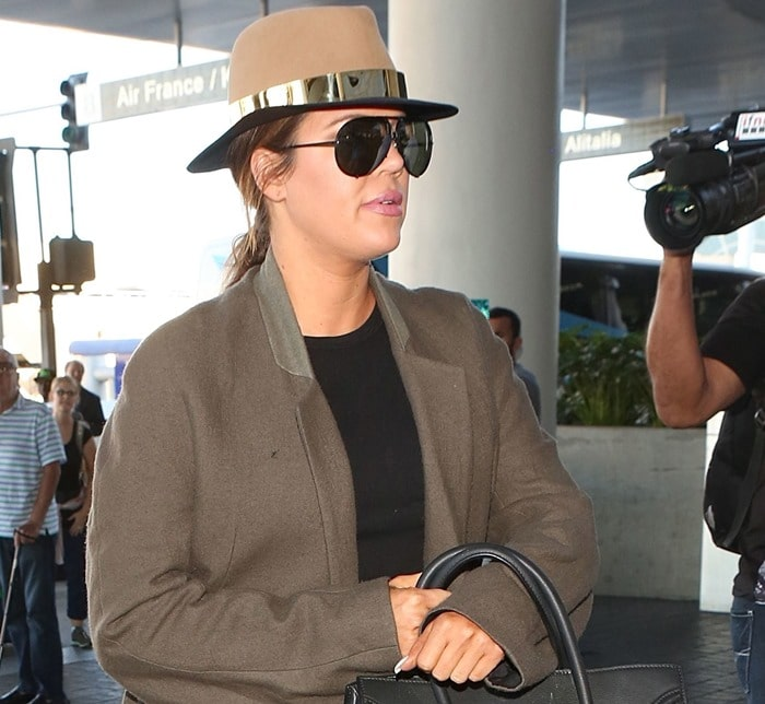 Khloe Kardashian wearing a trench coat by Haider Ackermann