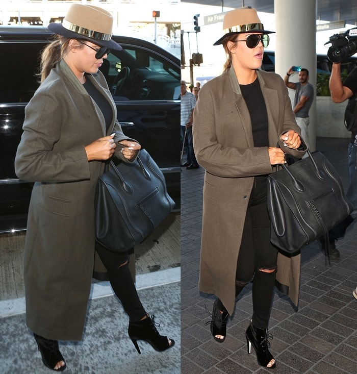 Khloe Kardashian totes a Celine tote while departing from Los Angeles International Airport (LAX) in ripped denim jeans