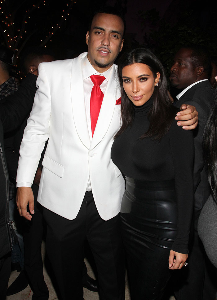 Kim Kardashian, posing with French Montana, in a Wolford turtleneck bodysuit and a leather skirt