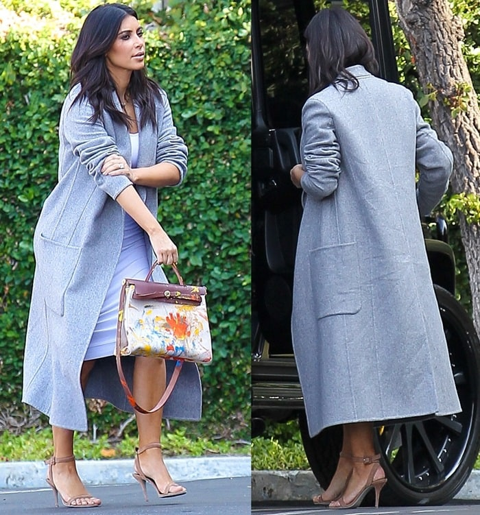 Kim Kardashian sported a tight white dress paired with a gray Celine coat