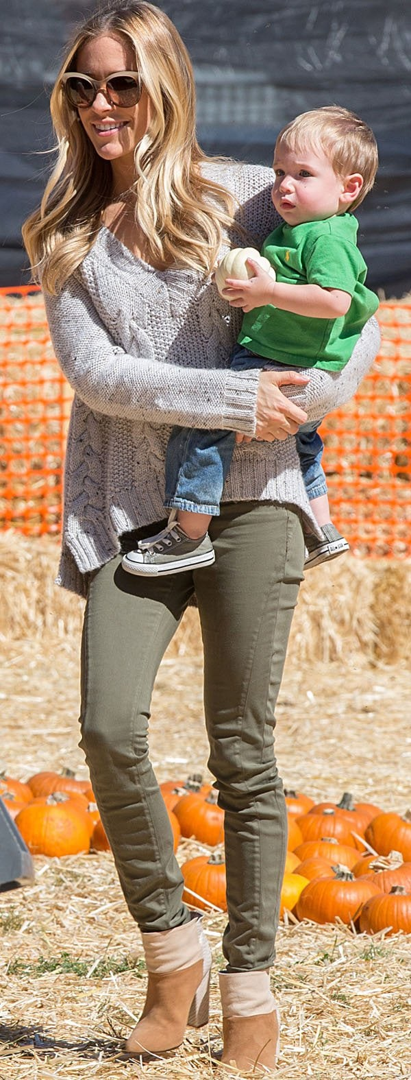 Kristin Cavallari in a cropped cable knit sweater and green pants