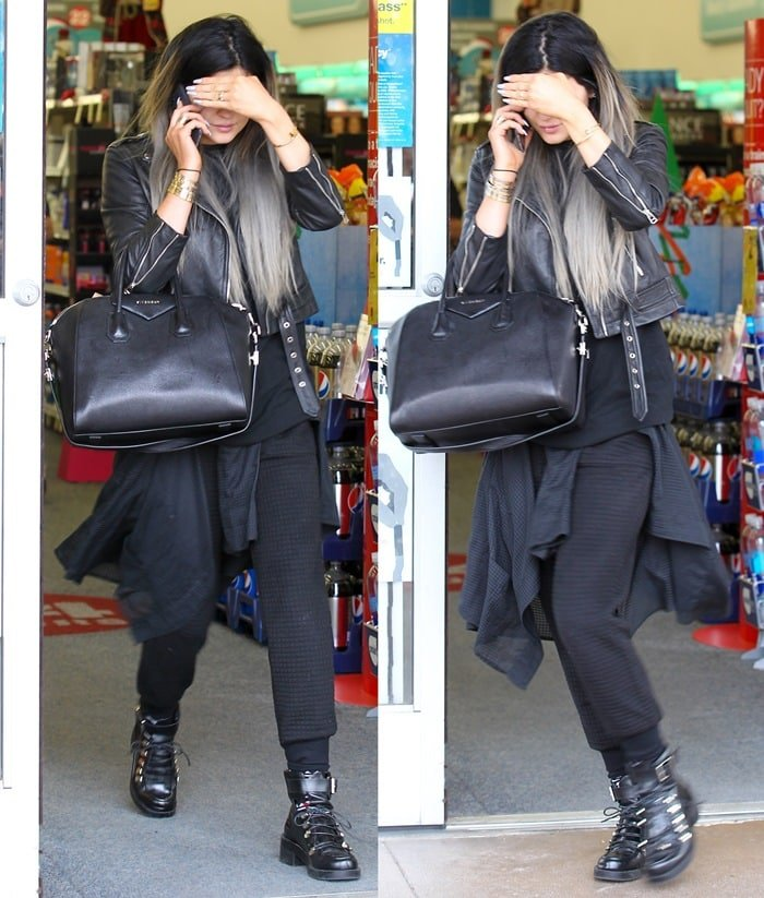 Kylie Jenner wearing a black leather motorcycle jacket and toting a black Givenchy bag