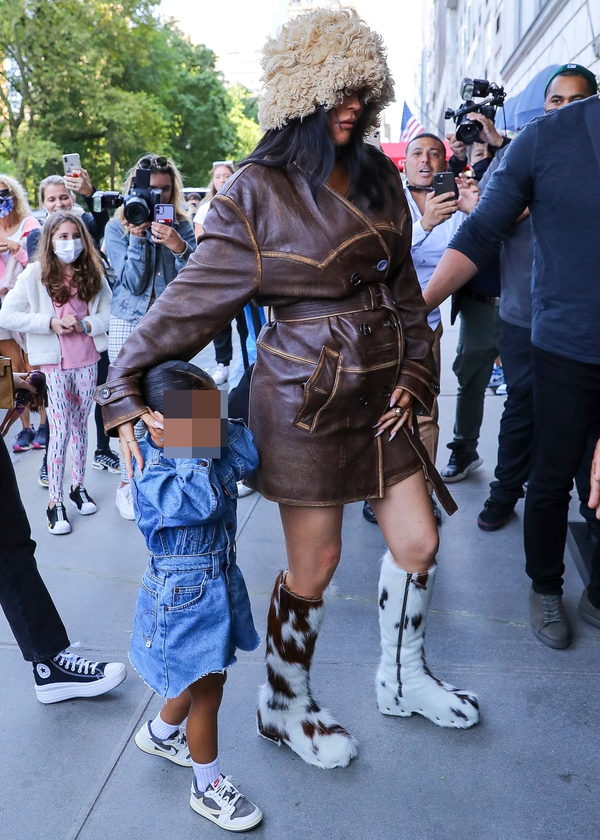 Pregnant Kylie Jenner and her daughter Stormi Webster arriving back at their hotel in NYC