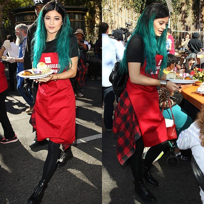 Kylie Jenner distributing meals of traditional Thanksgiving dishes at the Los Angeles Mission's Thanksgiving Meal for the Homeless event