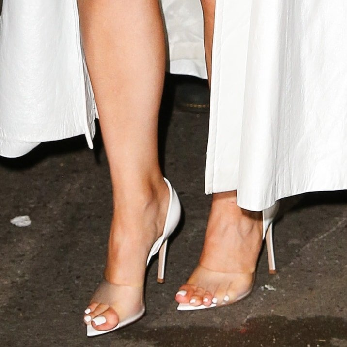Kylie Jenner shows off her feet in Bree d'Orsay pumps from Gianvito Rossi featuring a tonal PVC top strap