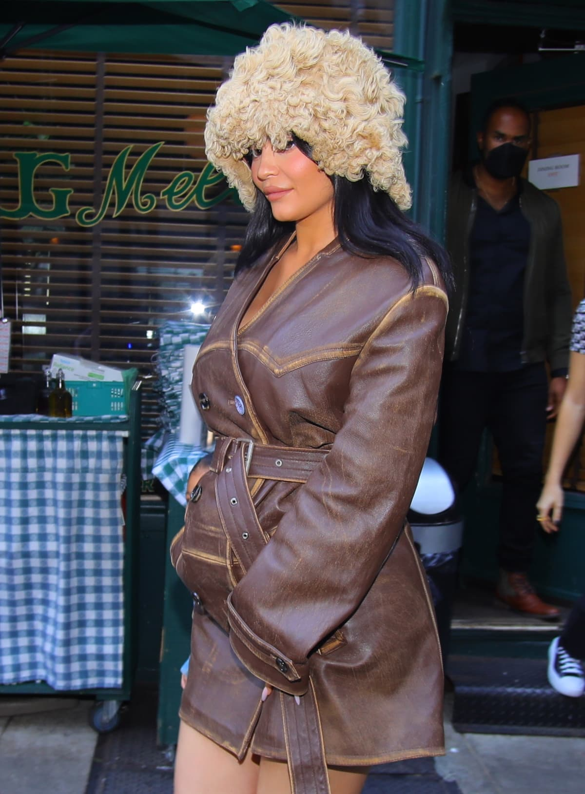 Kylie Jenner in a fur hat and a leather coat as she holds daughter Stormi's hand after lunch at the iconic Upper East Side restaurant J.G. Melon