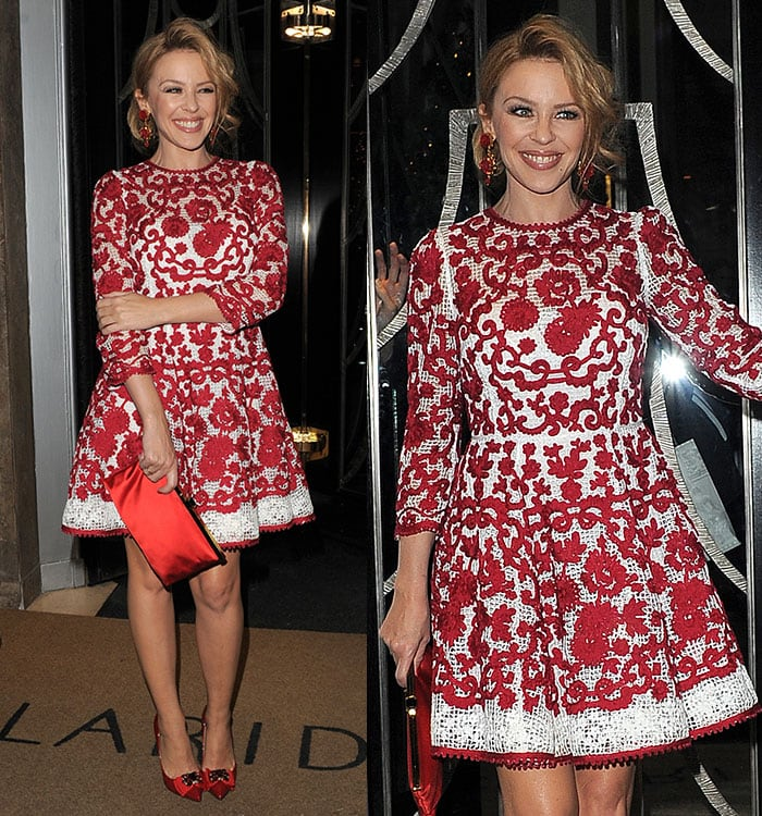 Kylie Minogue'stoned legs in a flirty white frock with red floral embroideries